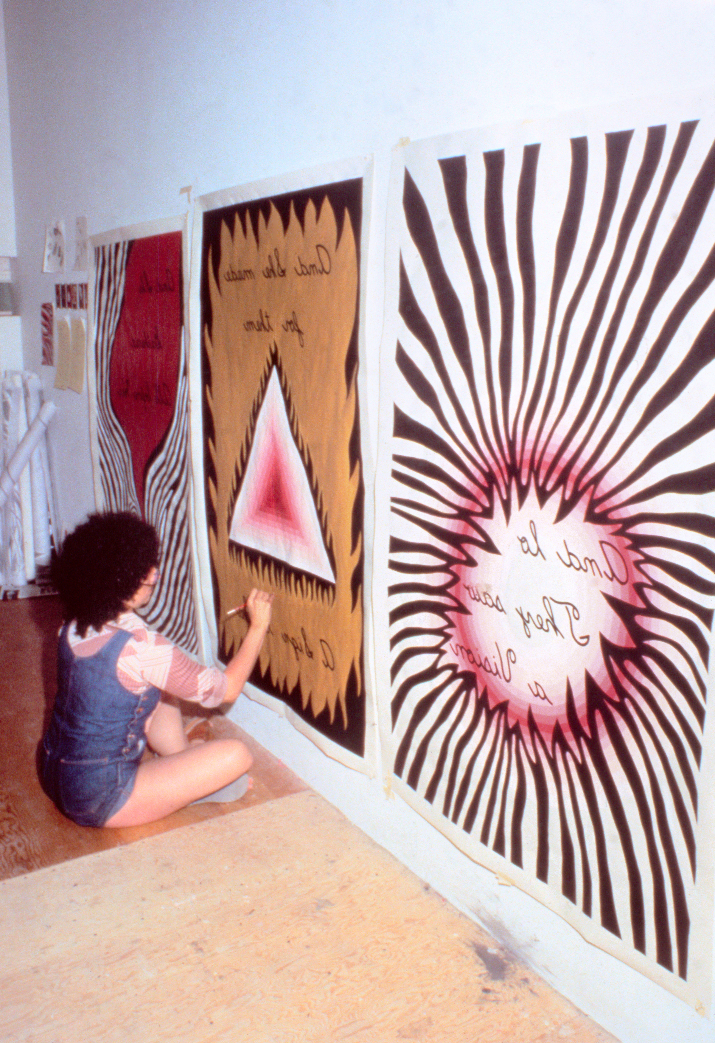 Judy Chicago painting the color cartoons for The Dinner Party Entryway Banners, 1977