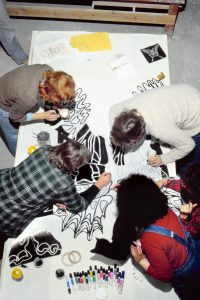 Judy Chicago and participants working on the Natalie Barney Runner Drawing, 1978