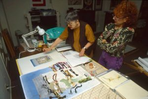 Helen Eisenberg and Judy Chicago discuss the needlework for A Chicken in Every Pot, 1997