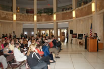 NM State Senator Michael Sanchez introduces Judy Chicago to the assembled crow