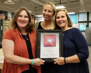 On behalf of Through the Flower – and the generosity of author Faye Kellerman, Leah Krueger, Jessica Provow, and Anne Baker from Virginia Beach Middle School are presented with The Judy Chicago Art Education Award in 2017 for their exemplary nine-week classroom implementation of Creating Tribute: The Judy Chicago Project.