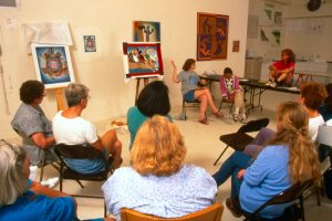 Judy Chicago with Resolutions needleworkers, many of whom had worked with her on the Birth Project in Belen, NM. 1997