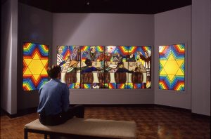 Rainbow Shabbat from the Holocaust Project ,1992. Stained glass fabricated by Bob Gomez. Hand paintedby Dorothy Maddy from Judy Chicago's car toon,4'6″h x 16'w installed installed at